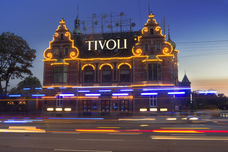 Copenhagen, Denmark - 24 September, 2017:  Building of Tivoli amusement park at evening, Copenhagen, Denmark. Tivoli is a very popular entertainmet place gathering crowds of people.