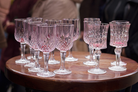 People finished drinking cherry liquor outside and left their empty glasses on the table, Lviv, Ukraine