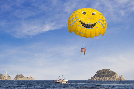 Marmaris, Turkey - 17 August, 2017: A pair of people having fun while paragliding in the sky at Turkish resort in summer. Editorial