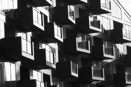 Copenhagen, Denmark - 26 September, 2017: Modern residential buildings in Copenhagen. Architectural detail in black and white.