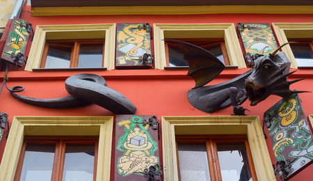 Lviv (Lvov), Ukraine, October 2017: The facade of the famous restaurant House of Legends, a sculpture of a dragon.