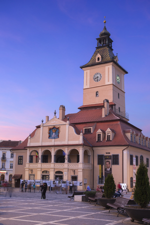 Brasov, Romania - 28 April, 2018: View at sunset council house in the center of the city.
