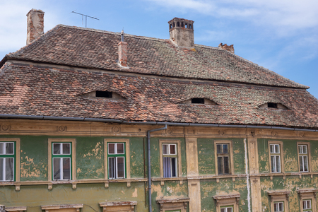 Typical house with eyes on the roof in Sibiu, Romania Stock Photo - 104394695