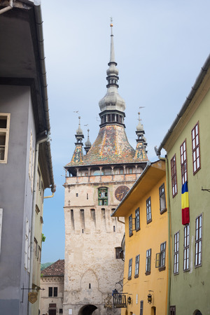 Clock tower of Sighisoara - one of the most popular touristic places, Romania Stock Photo - 104394720