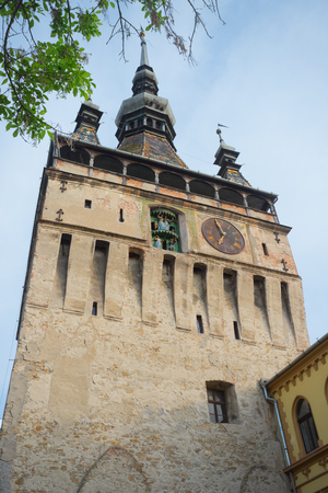 Clock tower of Sighisoara - one of the most popular touristic places, Romania Stock Photo