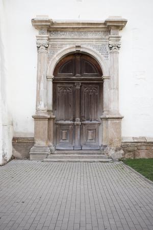 The door of the Evangelical church tower in Bistrita, Romania Stock Photo