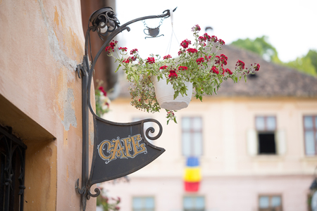 The sign Cafe and the flowers at local restaurant in Sighisoara, Romania
