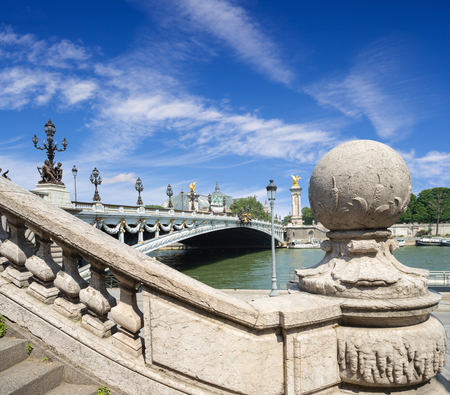 Bridge of Alexander III in Paris in sunny day with a blue cloudy sky, view from the stairs, Paris, France