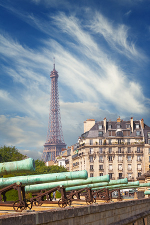 View on cannons of National Residence of the Invalids (Les Invalides) and Eiffel tower in Paris, France Stock Photo - 104613511