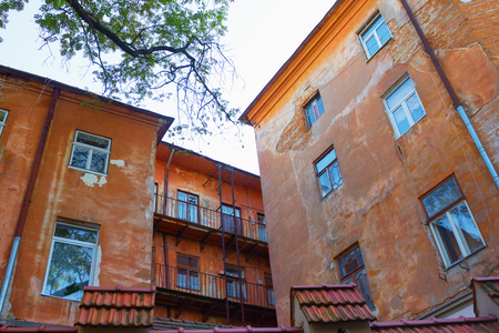 Ancient orange building in Lviv, Ukraine. VIew from the courtyard.