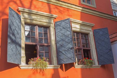Window shutters of the orange building in Lviv, Ukraine
