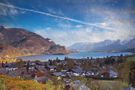 A picturesque landscape of Mondsee lake with multiple cottages on its bank in Salzkammergut region of Austria