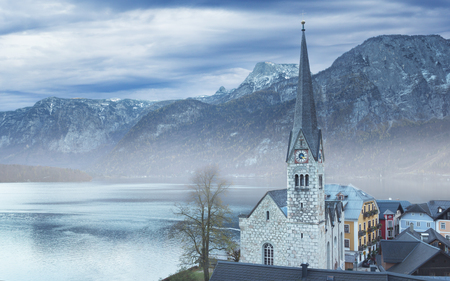 View on the foggy Halstatt and Protestant parish church, Austria Stock Photo - 119452573