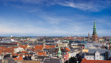 Cityscape of Copenhagen, Denmark. View on the roofs of city buildings and on the tower of Saint Nicholas church (Kunsthallen Nikolaj). Stock Photo