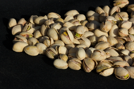 nibble: nuts on a black background