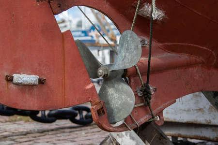 Detail shot of propeller and rudder on a motor boat