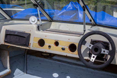 Renovation of motor boat with view of steering wheel
