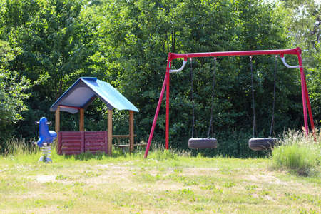 Childrens playground surrounded by trees and foliage