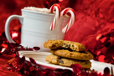 biscuits: Holiday Hot Chocolate and Cookies on Red Background at an Angle