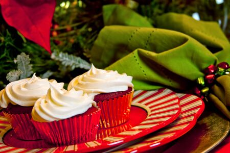 Red Velvet Cupcakes on a Holiday Table Setting photo