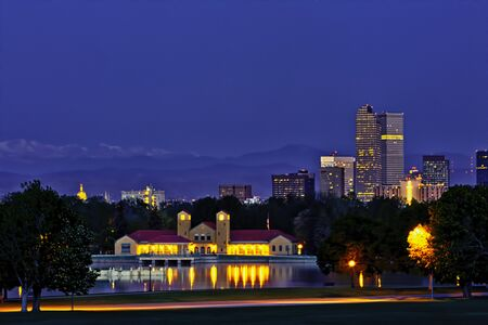 denver skyline with mountains: Denver Skyline from City Park Just Before Sunrise Stock Photo