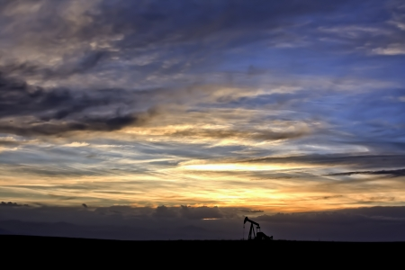 Dramatic Sunset Skies Over Oil Field with Oil Well Stock Photo - 13972405