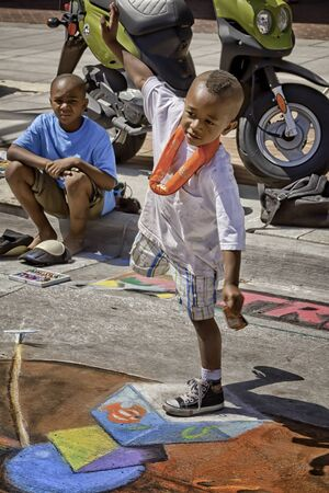 African American Boy Balancing on Sidewalk Chalk Art Mural