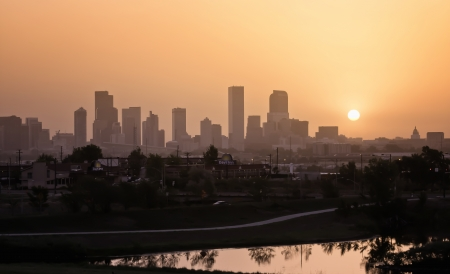 Denver Skyline with Hazy Skies and Lake Reflection photo