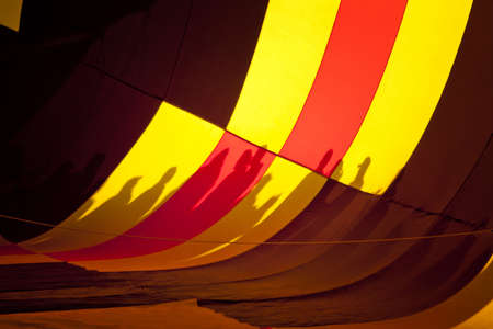 Shadows of People in Filling Hot Air Balloon photo