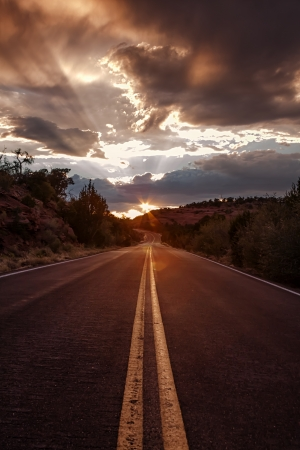 Sunlight Highway at Sunset with Dramatic Clouds and God Rays