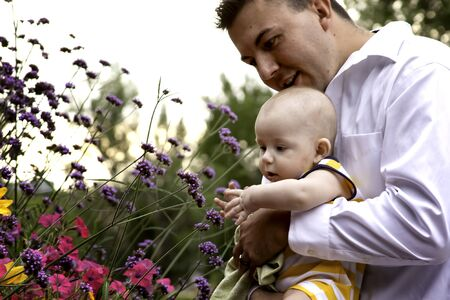 Dad and Baby Playing with Flowers