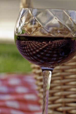 Close of wine in glass on picnic photo