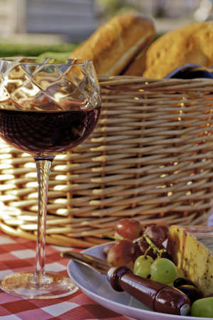 co cork: Glass of wine in front of picnic basket