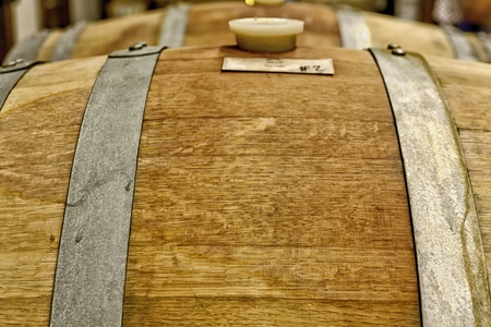 Close up of oak wine barrels photo