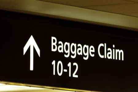 Baggage claim sign at airport photo