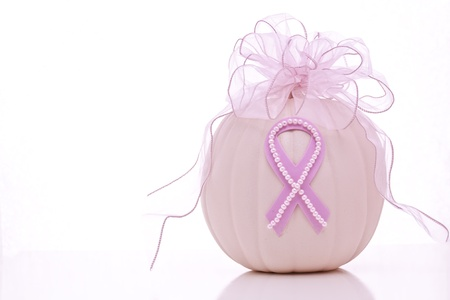Breast Cancer Awareness ribbon on pink pumpkin, topped with pink ribbon bow Stock Photo