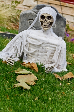 Halloween ghost in grave decoration photo