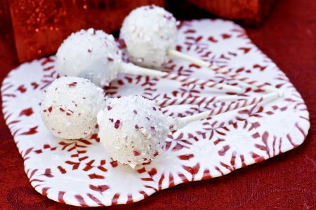 Christmas white chocolate cake pops on candy tray made of peppermints photo