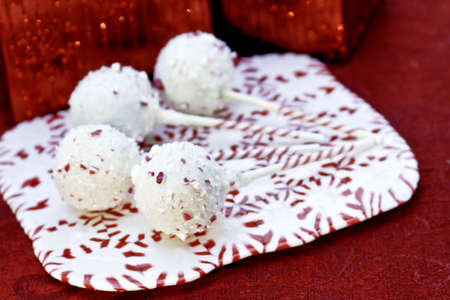 Christmas white chocolate cake pops on peppermint candy tray photo