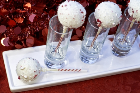 Christmas chocolate peppermint cake pops in dessert glasses on white plate photo