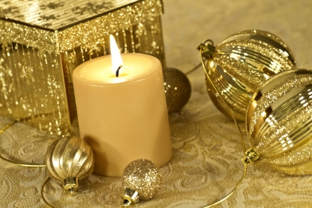 Christmas decorations in gold on glitter tablecloth photo