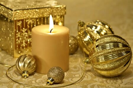 candes: Holiday decorations on table with Christmas ornaments and light candle