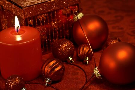 red tablecloth: Red holiday decorations on red tablecloth with Christmas ornaments and ribbon