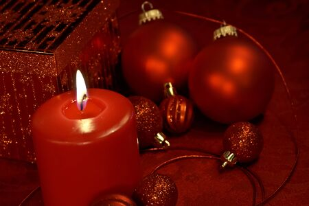 candes: Red glitter Christmas decorations with ornaments, candle, present and ribbon