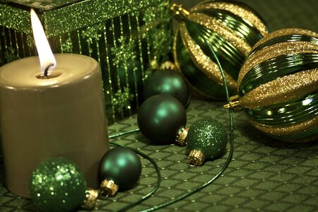 candes: Christmas ornaments, ribbon, presents and candle in green Stock Photo
