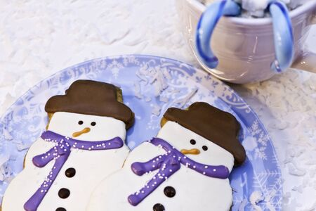 Christmas snowman cookies on blue plate photo