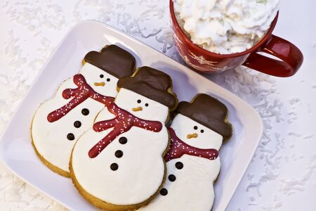 Christmas snowman cookies on white plate Stock Photo