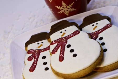 Christmas cookies on white plate with cup of hot chocolate photo