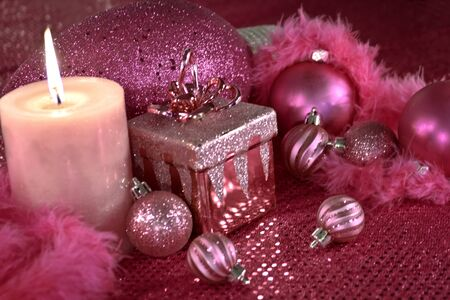 Hot pink Christmas decorations with present, feather garland and ornaments Stock Photo - 16510215