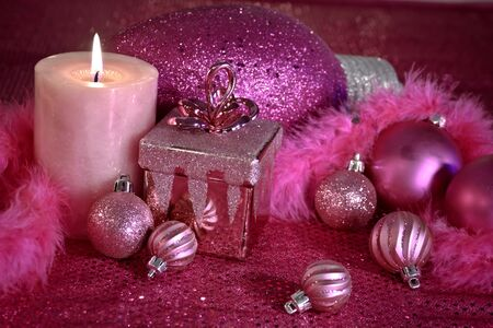 Pink holiday decorations on pink table cloth Stock Photo